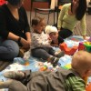 Infants and parents playing at story time.