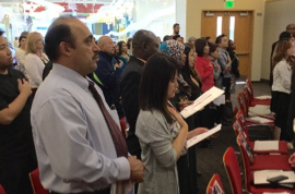 New U.S. citizens pledging their citizenship at the library